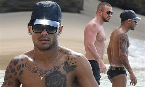 marcus collins sizzles in tiny swimming briefs with