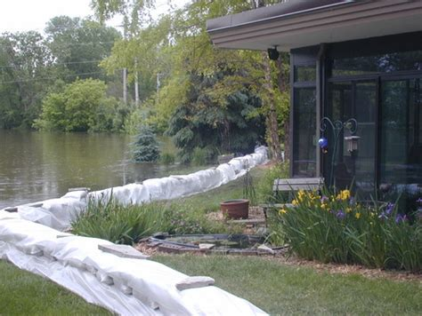 How To Stop Backyard From Flooding by Thinking Of Raised Flower Beds As Water Flood Barriers