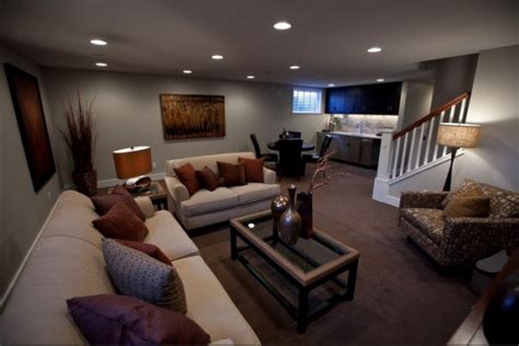 Basement Improvement by Hidden Lamps Cream Sofa Grey Wall Brown Rug White Stairs