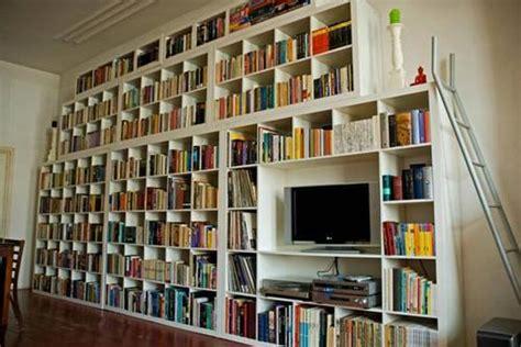 ganging up ikea shelves for a striking cheapass wall o