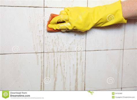 cleaning dirty bathroom tiles cleaning of dirty old tiles in a bathroom stock photo