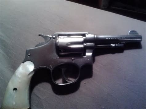 38 F Stainless Darat Dalam 38 Inch i a 38 s w special ctg with stainless steel 4 inch barrel pearl handle gun values board