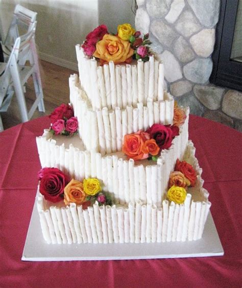 Wedding Cake Companies Near Me by 4 Tier Wedding Cake With Chocolate Cigarettes Yelp