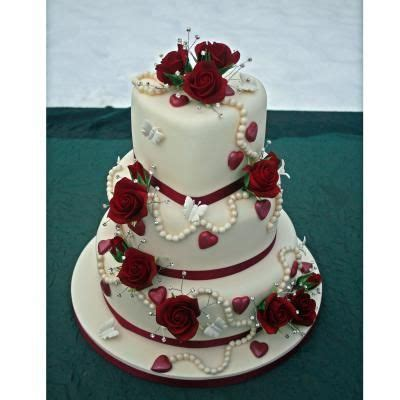 3 tier cake with a Heart shaped top tier