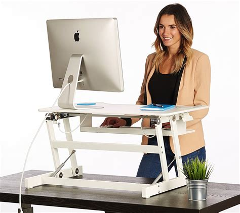 adjustable desks for standing or sitting standing desk the deskriser height adjustable heavy