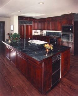 Cherry Wood Kitchen Cabinets With Black Granite My Kitchen Black Granite Countertops With Cherry Wood Cabinets And Black Appliances