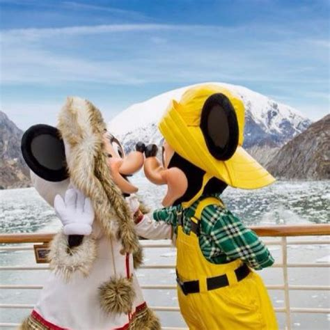 mickey and minnie on the alaskan disney cruise giving each