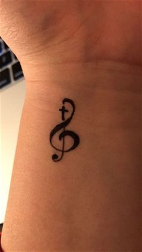 treble clef cross tattoo treble clef ankle almost the size of a quarter