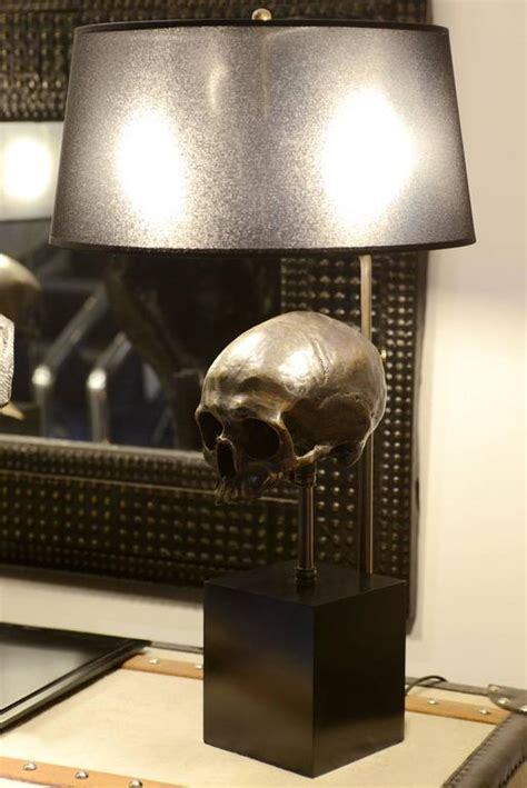 l skull in brass with black transparent shade and skull