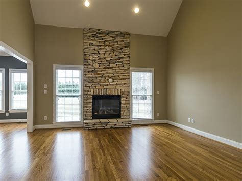 Fireplace Floor To Ceiling Ideas by Floor To Ceiling Stacked Fireplace Flanked By