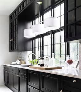 Day birger et mikkelsen kitchen black cabinets marble countertop lonny
