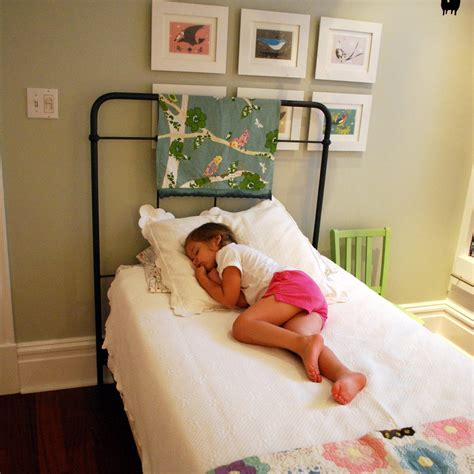 girl in bed little girl big bed third story ies
