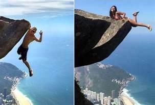 photo hanging leonardo edson pereira and victoria medeiros nader dangle off a rock 2 769 feet above rio