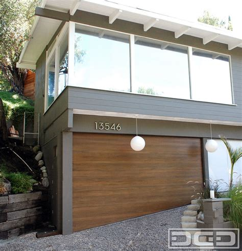 Uneven Garage Door by Modern Garage Doors With Sloping Bottom Sections For