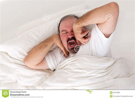 wake up everybody no more sleeping in bed tired man stretching in an effort to wake up royalty free stock image image 36473866