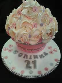 Pin giant cupcake cake for a pretty little girl huggies birthday