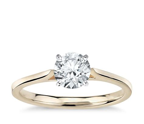 cathedral solitaire engagement ring in 14k yellow