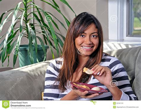 woman eats couch beautiful multiracial woman eating hummus on couch stock