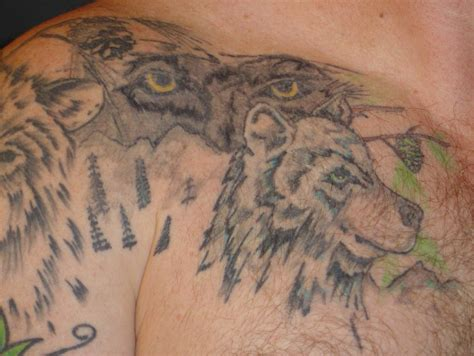 hd 3d wolf with blue eyes tattoo design idea