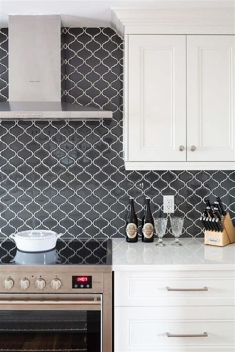 black glass backsplash kitchen white cabinets with black arabesque tiles