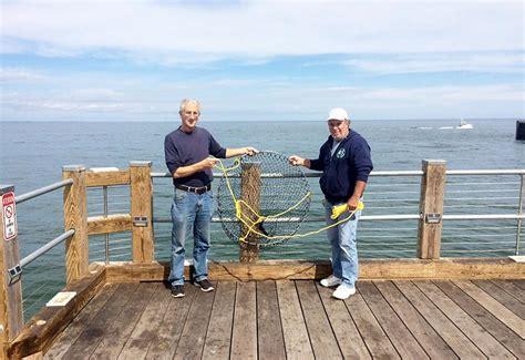 pier fishing net oak bluffs pier fishermen get a helpful tool the martha