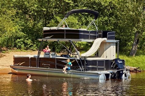 luxury pontoon boats with slide you can t miss premier s new two story escalante pontoon