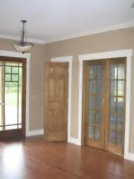wood trim vs white trim pictures of houses with wood colored interior trim doors and non white walls
