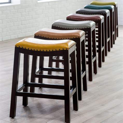 Leather Saddle Style Bar Stools by Belham Living Hutton Leather Backless Saddle Counter Stool