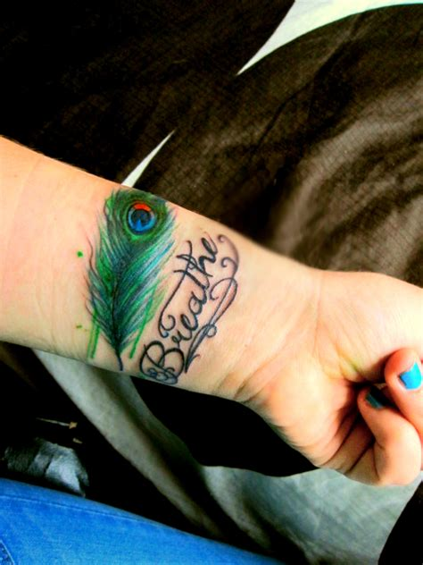 peacock feather tattoo on wrist feather tattoos page 2