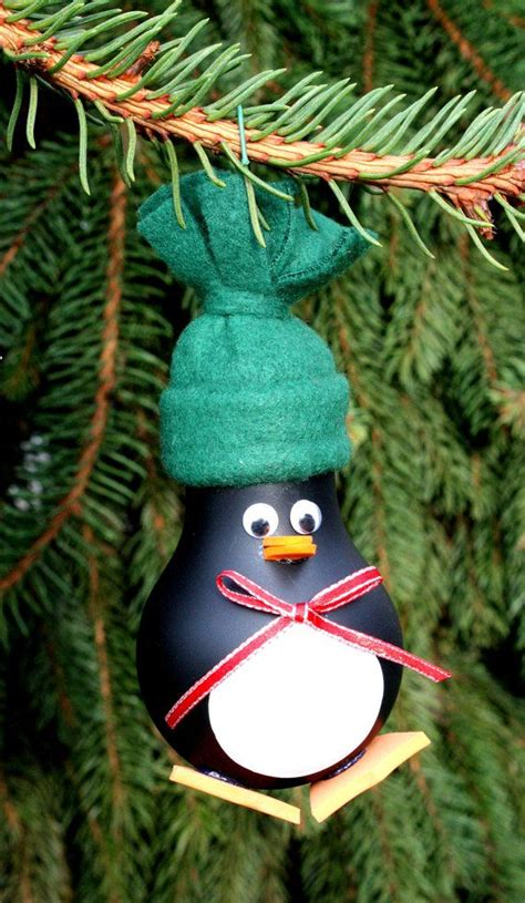 penguin christmas tree ornament made from a recycled
