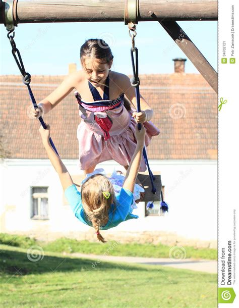 Swing On This Two Swinging On Swing Stock Image Image