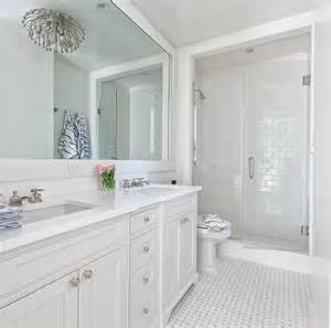 white bathrooms kohler adjustable shelf with electrical outlets transitional bathroom the hunted interior