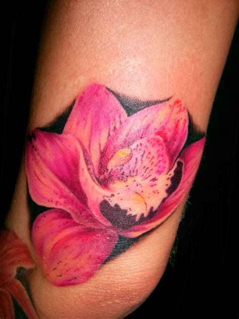 wild tattoos flower on arm