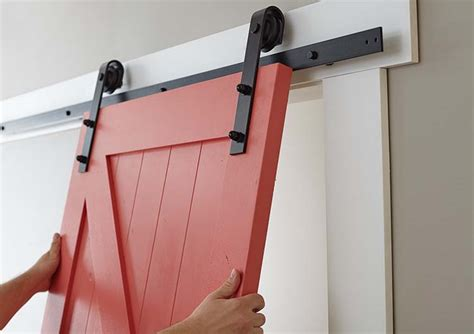 Easy Barn Door Paint And Install The Home Depot Blog Hanging Barn Door Track
