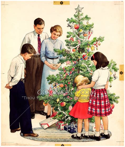 family prays beside christmas tree