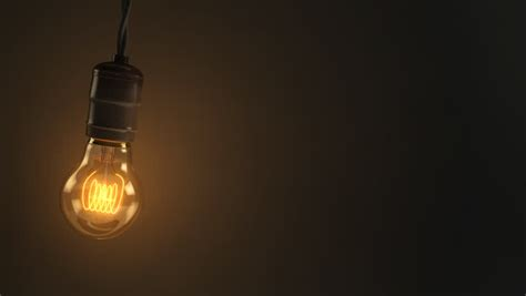swinging light lightbulb stock footage video shutterstock