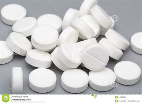 download medical pills tablets and capsules on white and heap of white round tablets medical stock photo image