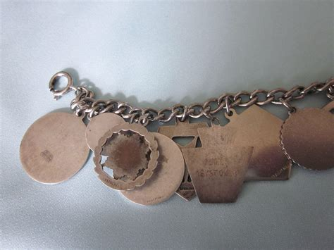 vintage 1960 s 70 s eastern oes loaded charm bracelet