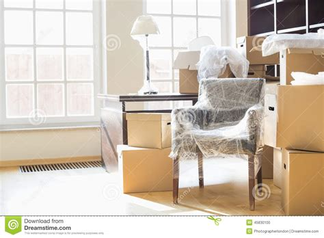 chair boxes moving moving boxes and furniture in new home stock photo image