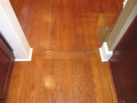 transition between old wood floors and new old and new hardwoods with a transition strip
