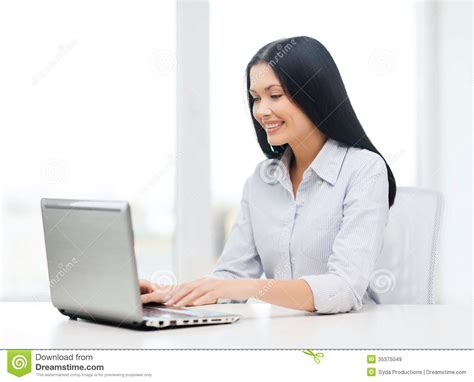 student on computer smiling businesswoman or student with laptop royalty free