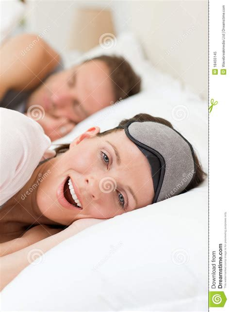 lovely couple in bed lying in bedroom lovely couple lying down in their bed royalty free stock