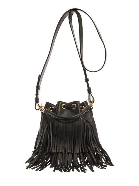 laurent fringed leather bag in black lyst