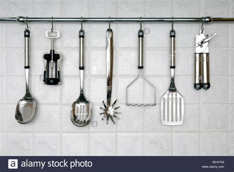 Hanging Utensil Rack For Kitchen by Stainless Steel Kitchen Utensils Hanging On A Rack