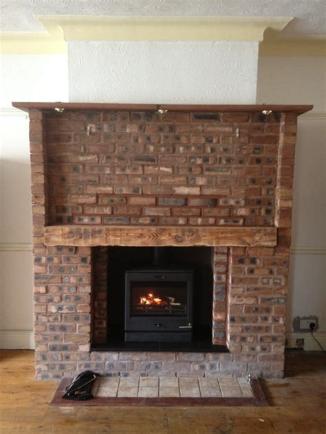 Brick Fireplace With Stove by Portfolio The Barn