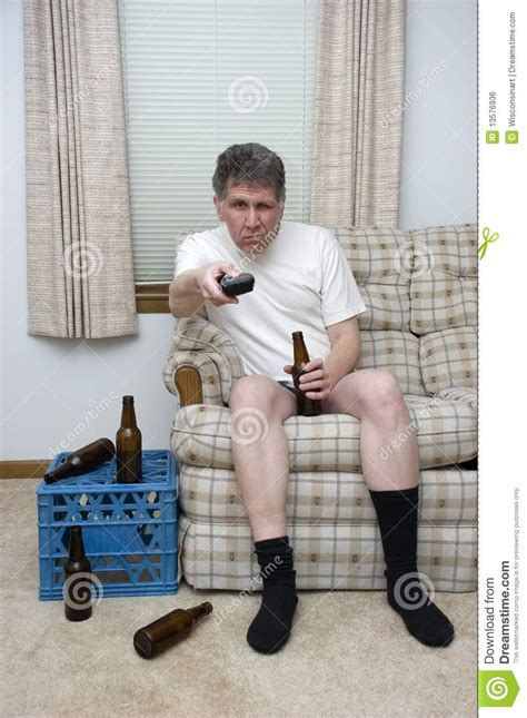 slob on couch lazy man couch potato slob drunk with tv remote stock