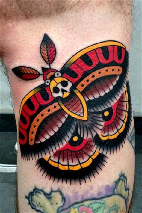 arm old moth tattoo by montalvo tattoos