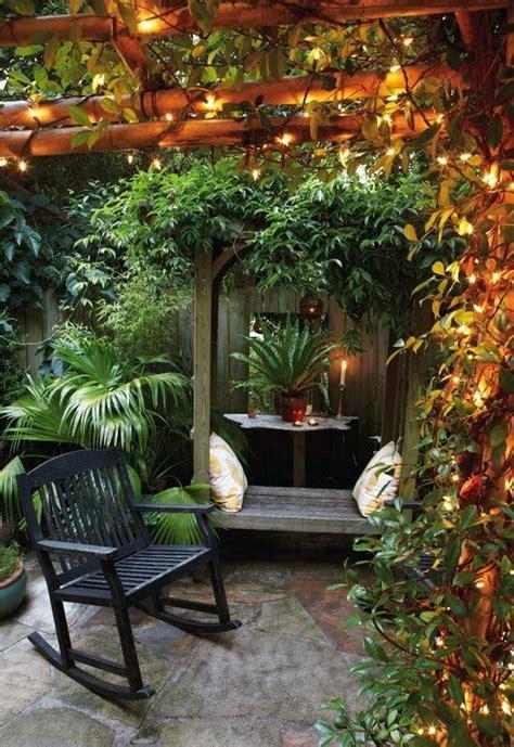 romantic and cozy atmosphere under a pergola i love the small backyard home design idea