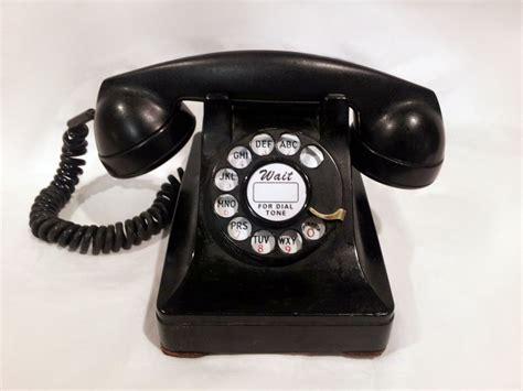 black on the phone working black rotary phone 1950s