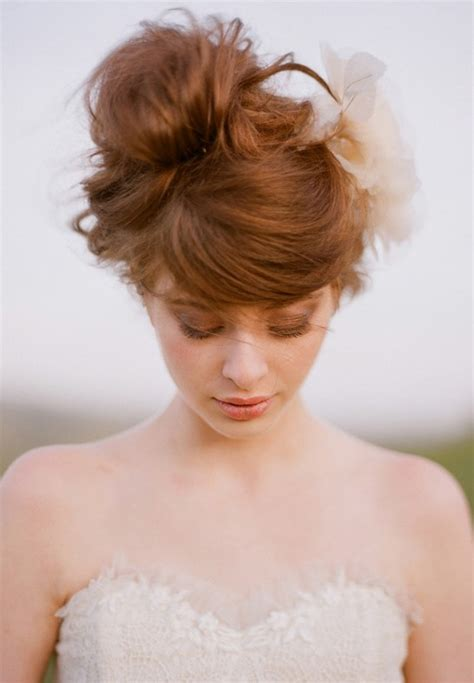 wedding hair messy bun view from front romantic wedding updo swirly sophisticated russet updo